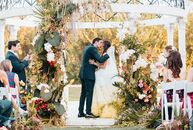 "Perry Silverman and Adam Rosen based their wedding on ""La Vie en Rose"" as a nod to Perry's love of flower arranging and their hashtag, #chosenrosen. T"