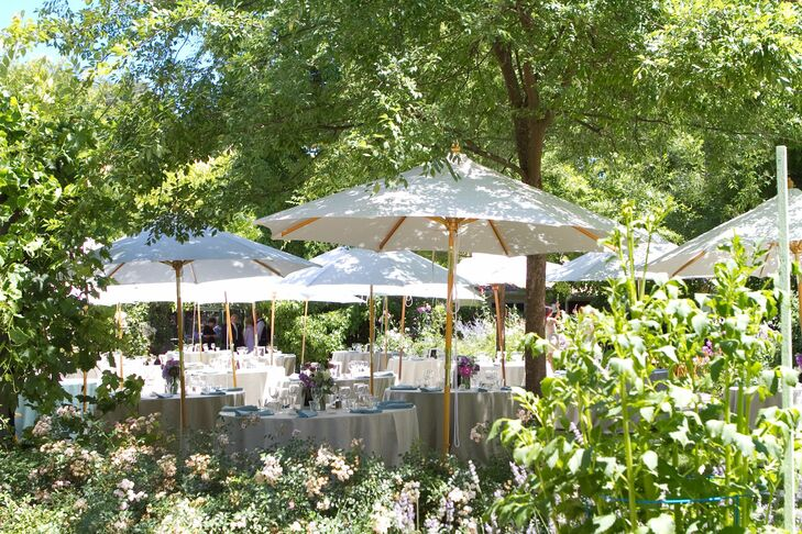 An intimate garden reception followed the ceremony. White umbrellas, pastel linens and bright summer blooms complemented the lush backdrop, adding a whimsical feel to the afternoon.