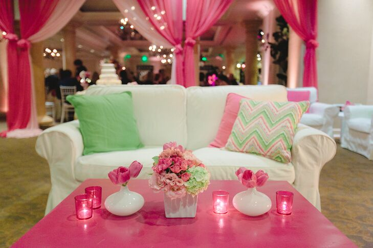 Guests were able to relax at a separate section of the reception, where white sofas with colorful pillows were arranged next to bright pink coffee tables. The tables were decorated with small flower centerpieces, filled with tulips, hydrangeas and roses surrounded by small candles.