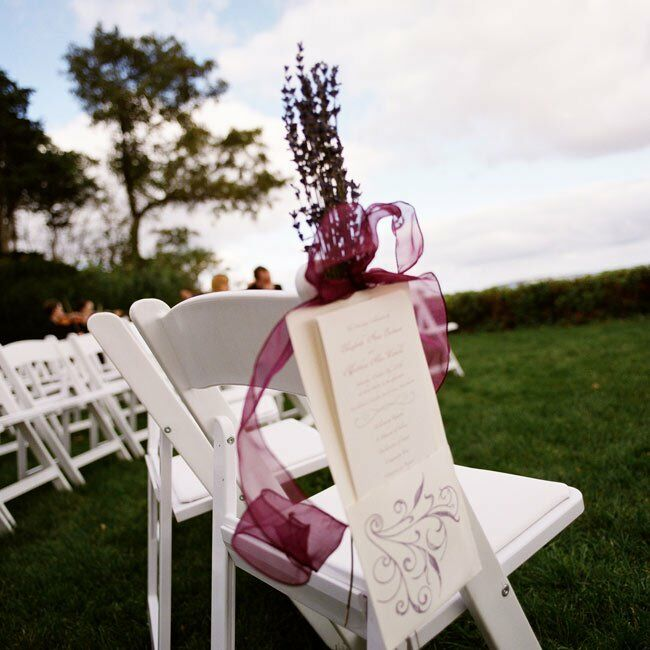 Program holders were attached to each aisle chair. Not only were they functional, but the holders also doubled as decor with the addition of dried lavender and colorful ribbon.