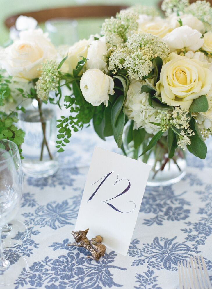 Each table number was held by silver or gold magnetic holder shaped like various animals.