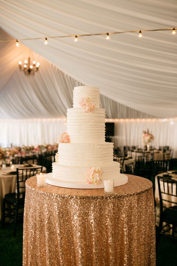 Guests enjoyed the wedding cake, made by Cookie Basket, which consisted of four layers and flowers as decoration.