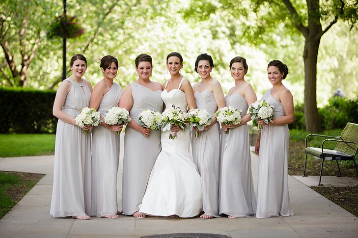 """The bride chose oyster colored floor length dresses in chiffon for her bridesmaids, and she let each of them pick the neckline they liked best. """"It was fun because each dress showed their personalities!"""""""