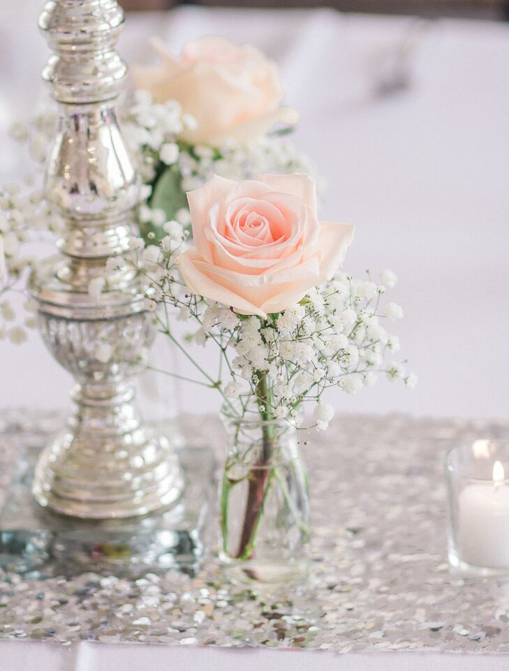 Baby's breath dressed up the blush roses that served as centerpieces on some of the reception tables. The sequined runners added to the glamorous setting.