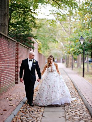 Elegant Couple in Formal Black-Tie Attire and Floral Ball Gown