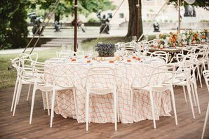 White Reception Chairs and White-and-Orange Reception Linens