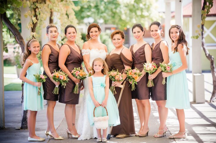 The bridesmaids' chocolate brown sheath dresses felt classic and sophisticated, while the junior bridesmaids and flower girls' pale blue dresses had a more youthful look.
