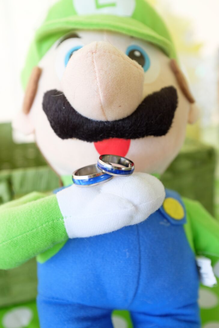 The couple displayed their rings on an adorable Luigi plush doll.