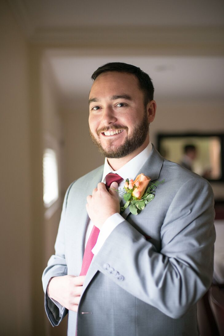 Kyle wore a light gray suit with a burgundy tie to his fall wedding.