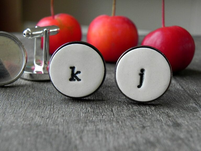 Custom ceramic cuff links pictured with initials K and J