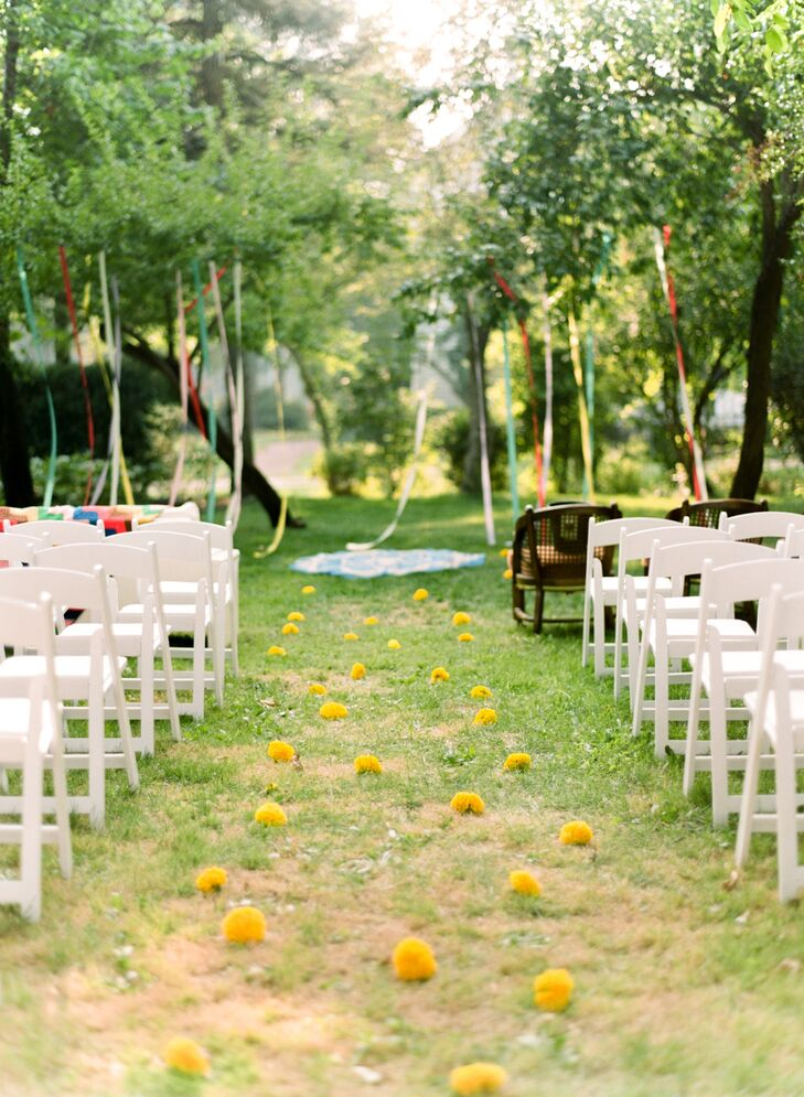 Natural Aisle Dotted with Yellow Marigolds and Ribbons