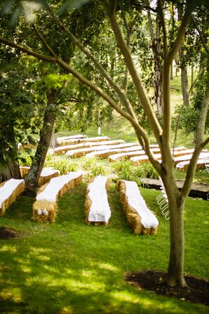 Hay Bale Ceremony Seating With White Fabric