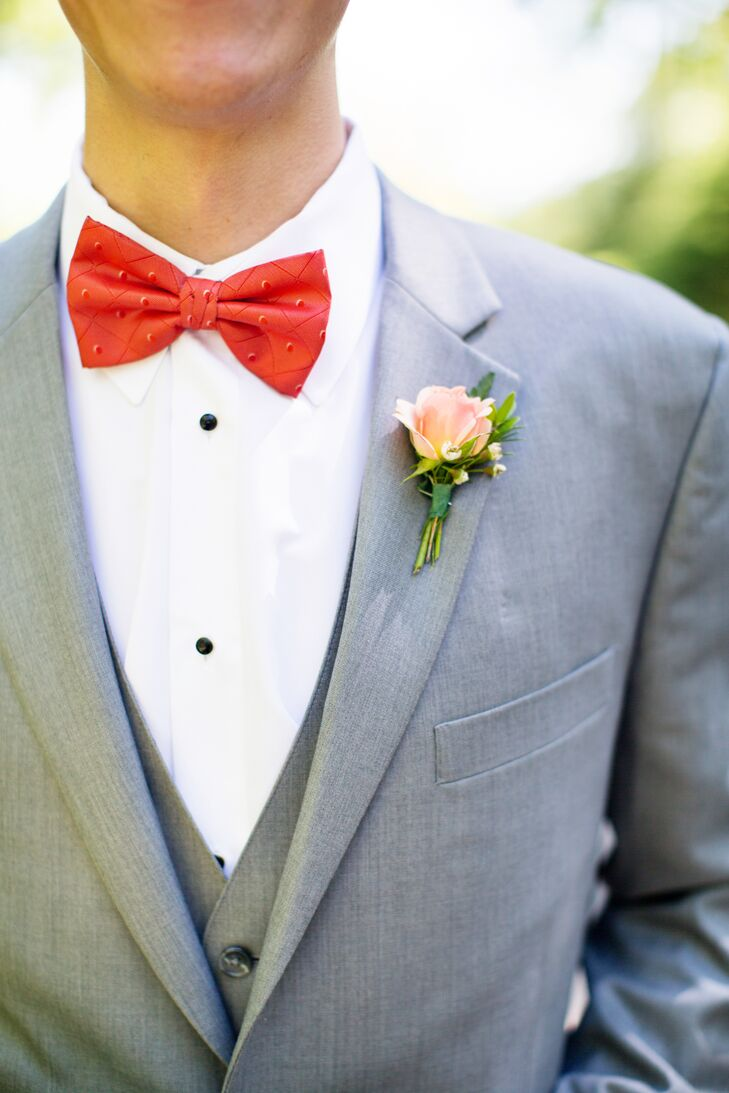 The groomsmen wore light gray 3-piece suits with Coral Bow Tie's contrasting with the groom's dark gray suit and sage green bow tie.