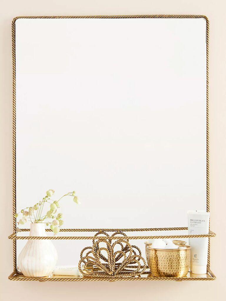 Gold mirror with storage shelf