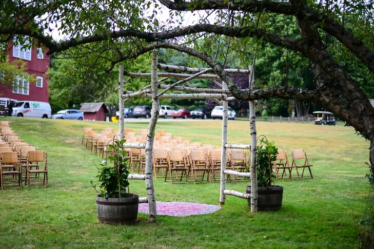 """One of the things that Keith and Brianna bonded over was their intense love of the outdoors, and the organic beauty that comes from what is already there. """"We knew right off the bat that we wanted an outdoor wedding without a set color palette, and focused on creating a minimalistic, rustic affair,"""" says Brianna."""