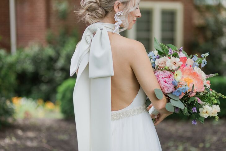 Elegant Wedding Dress with Back Bow and Colorful Bouquet