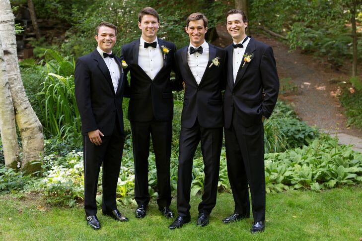 Dan's seven groomsmen wore classic black tuxedos with black bow ties.