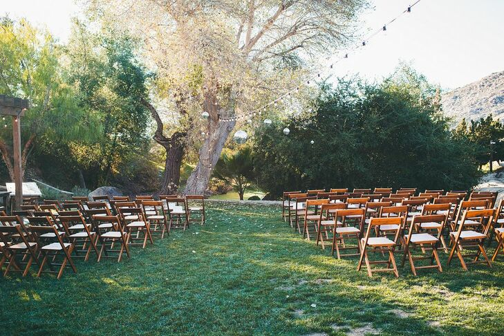 Casual Outdoor Ceremony with Folding Chairs and Hanging Disco Balls