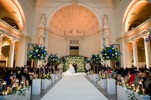 Modern, Luxurious Ceremony with Tall Aisle Decorations at the Field Museum in Chicago, Illinois