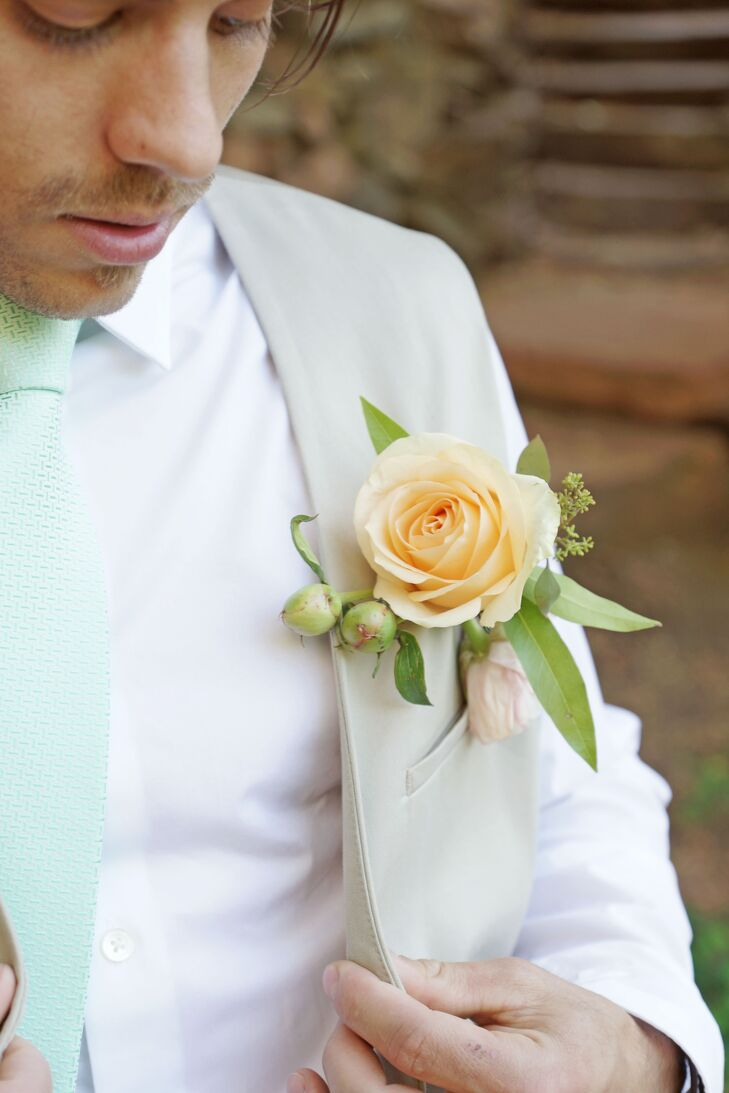 Dallan kept his style casual and wore a khaki linen vest and pants with a mint tie. His boutonniere was a peach spray rose with greenery that looked like it had been plucked from Ashlee's bouquet.