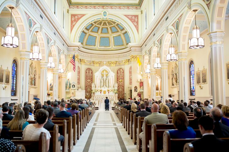 """Making the day as easy as possible for their guests was essential for MacKenzie and James, so venues that were easily accessible and close together were a must. """"St. Sebastian's was right down the street from our hotel, the Inn at Middletown and also on the way to the reception venue,"""" MacKenzie says. """"It had beautiful stone steps and a stone infrastructure. I looked at pictures of it and thought 'Holy cow, this is a church from a movie or out of Europe.' I felt I'd be lucky to be married there."""""""