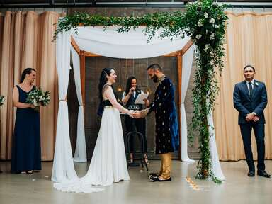 Exchange of vows ceremony with officiant, bride and groom
