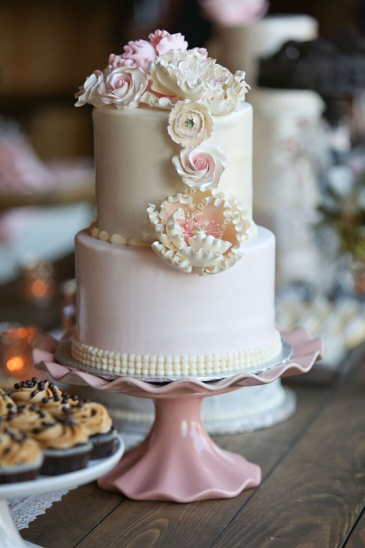 """Courtney is trained in patisserie, so desserts that were anything short of excellent weren't going to cut it. Her friend and former coworker at Gimme Some Sugar was happy to step in. """"I wanted something simple and easy for her to make, since she would be attending the wedding as a guest too,"""" says Courtney, """"but no! She wasn't going to allow me to settle for simple."""" The baking whiz created an unforgettable spread of two-tiered cakes, petits fours, cookies, cake pops and cupcakes. """"I let her do her thing, and we couldn't have been happier with what she made,"""" says Courtney. """"I loved that the sweets table even had my mom's chocolate chip cookies!"""""""