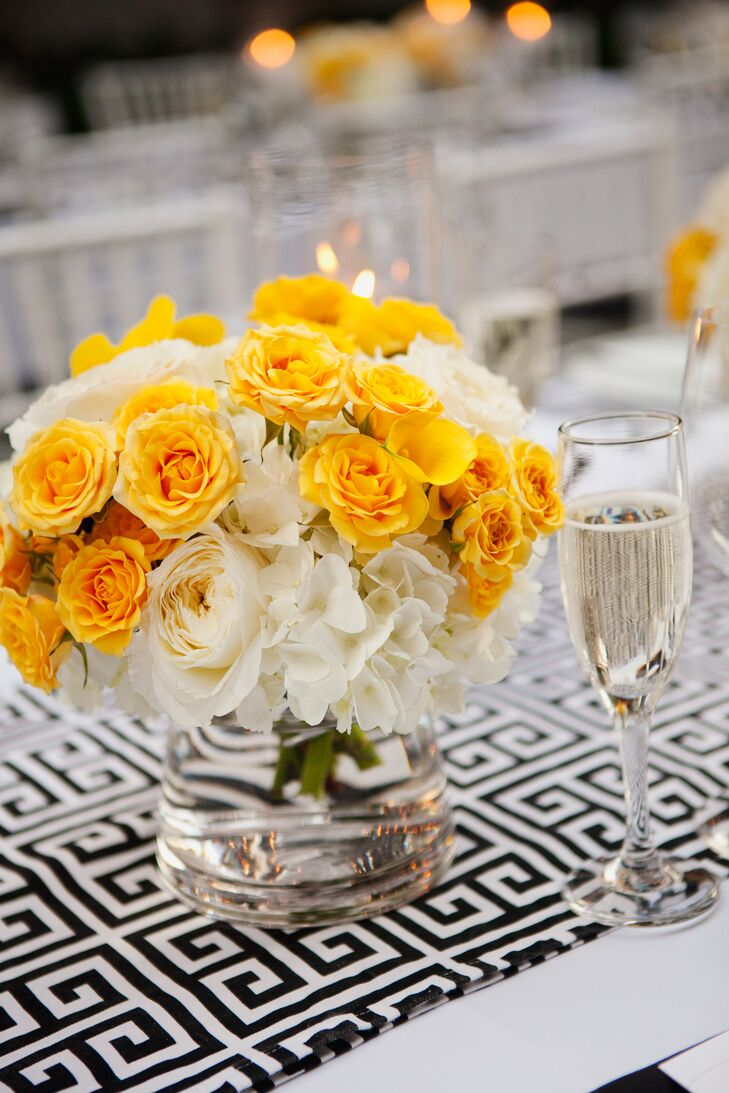 The dining tables had black-and-white runners designed with a Greek key pattern draped down the middle, decorated with white and canary yellow centerpieces of roses and hydrangeas.