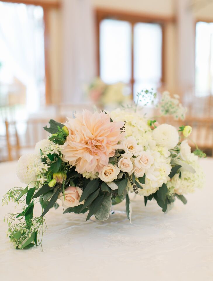 Flowers by Semia brought Liz and Andrew's whimsical, romantic vision to life with showstopping arrangements