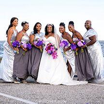 bride and bridesmaids posing on beach