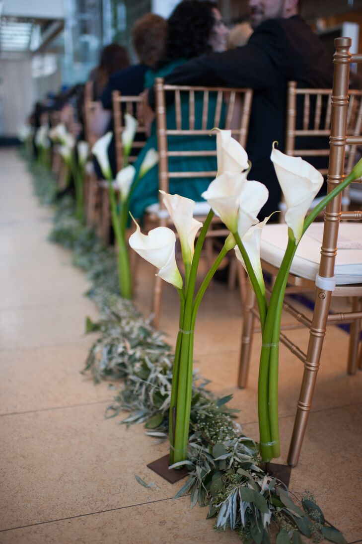 Marisa and Dan were married in the library's atrium, while their 200 guests sat on both sides of the lily- and garland-lined aisle.