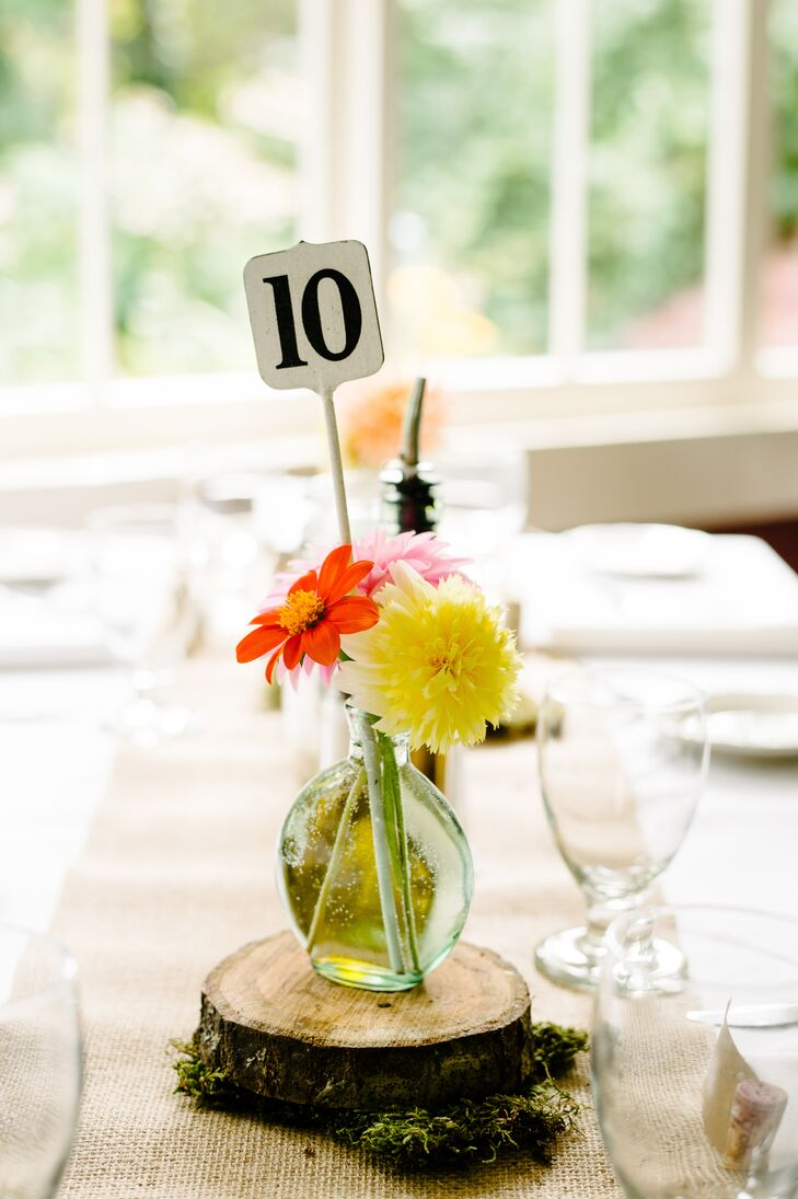 Playing up the rustic, natural theme, the restaurant's tables were topped with lengths of burlap and bright floral arrangements atop moss-covered tree slices.