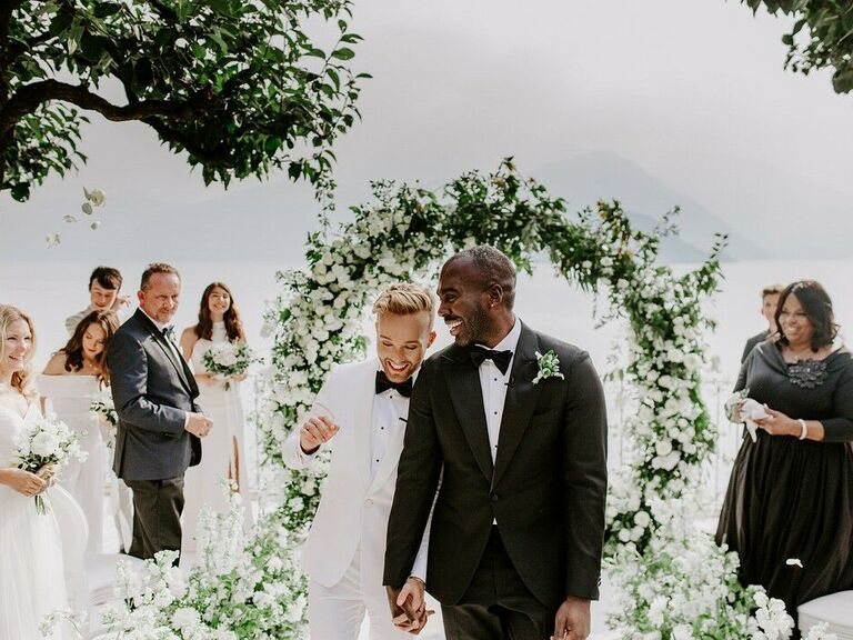 Couple walking down aisle in Italy