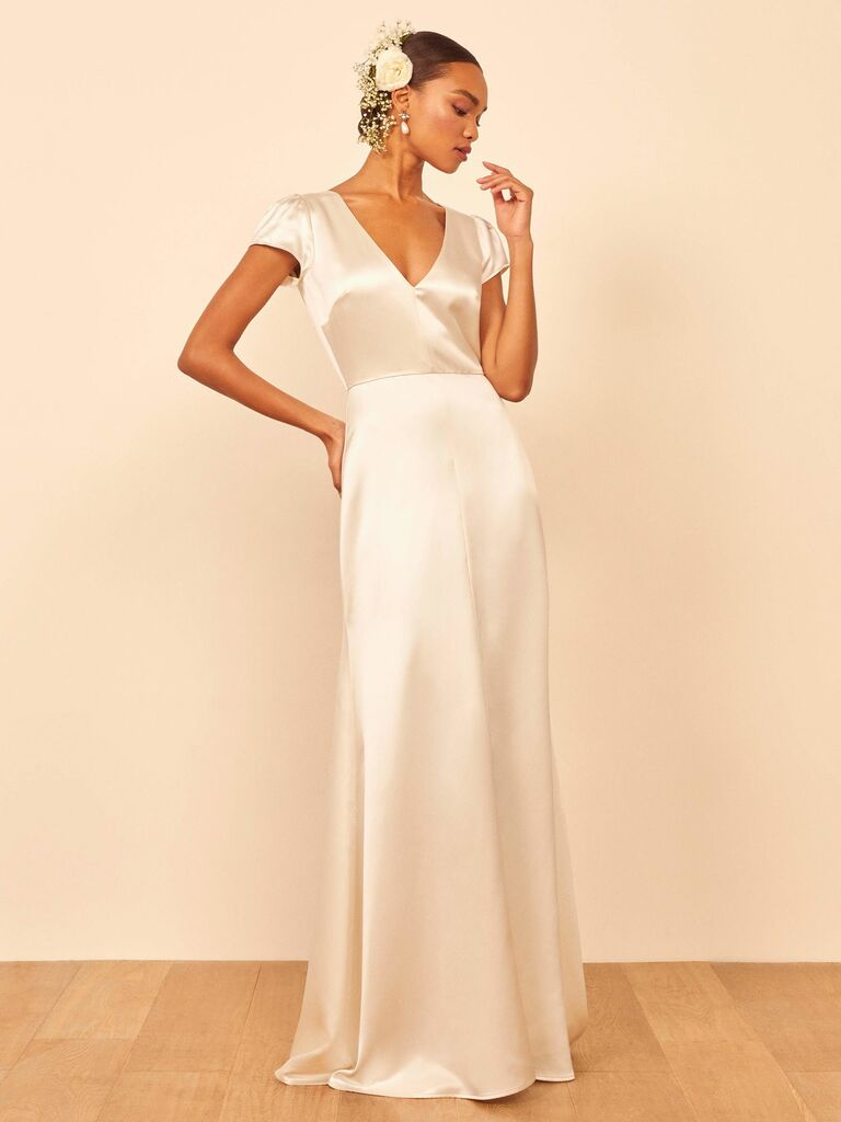 Long dress with deep v neckline and deep v back and puff sleeves