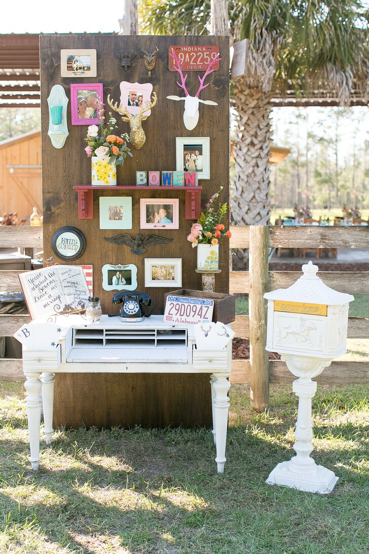 "We loved Katie and Austin's funky guest book display. Once again, Katie made it herself and covered a rustic wooden board with tons of photos of her and Austin. Each was placed in a bright pink or pastel frame surrounded by plastic deer mounts, roses and even a little shelf. ""I love how this project turned out,"" Katie says."