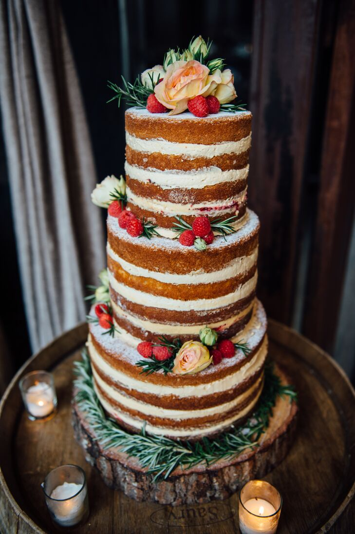 When it came to designing their wedding cake, Jennifer and Michael went with an unfrosted, naked cake to go with Brooklyn Winery's rustic vibe. The pastry chef at Sweet Chick, where Michael works, collaborated with the couple to dream up a fun, flavorful peanut butter and jelly cake — vanilla cake with peanut-butter frosting and raspberry comfit filling.