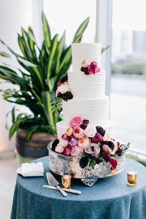 Tiered Buttercream Cake with Floral Accents