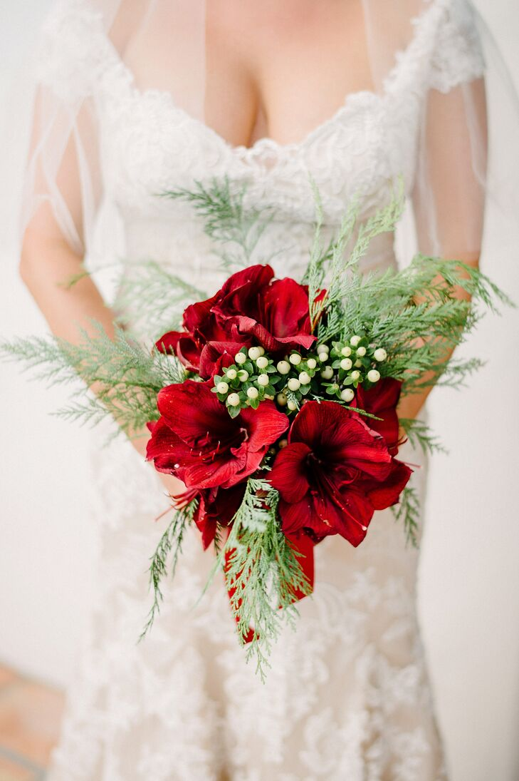"""Erin's bouquet set the tone for the rest of the day's arrangements. """"Timeless holiday decor was my goal, so I stuck with the tried-and-true favorites of red amaryllis, hypericum berries and fresh cedar sprigs."""""""