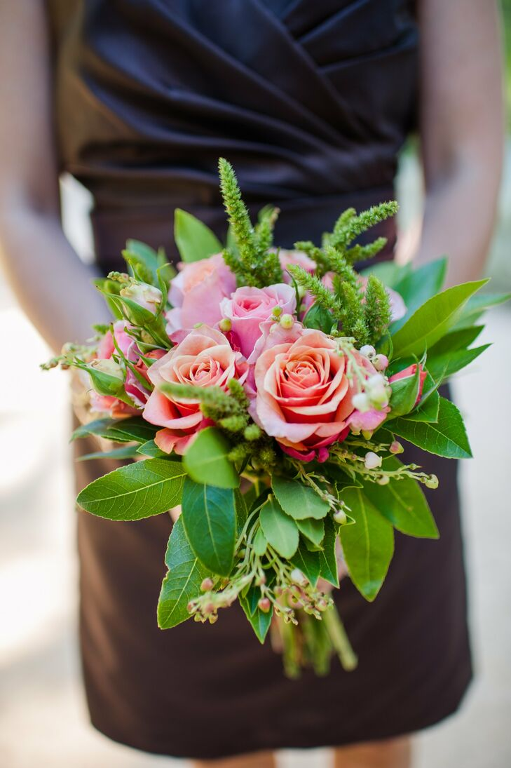 A small culster of pink roses was accented by a lush arrangement of greenery and astilbe in the bridesmaids' bouquets.