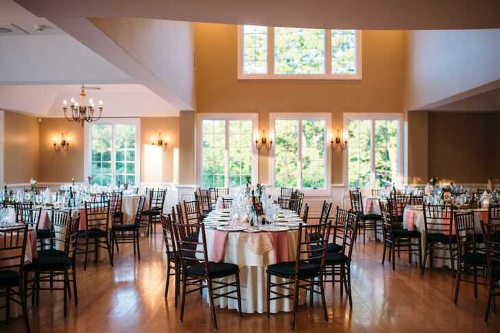 A mix of romantic and natural decor covered the Rock Island Lake Club for their Sparta, New Jersey, reception. Ivory linens and dusty rose napkins marked each oval or round table. Organic moss and low arrangements of pink roses served as centerpieces alongside colored glass votives and various vintage-style trinkets. The mixed designs nodded to their natural ceremony setting.