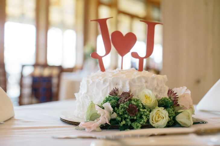 In addition to a dessert table with whoopie pies, cheesecake bars and brownies, the couple cut a small buttercream cake decorated with an initials cake topper.