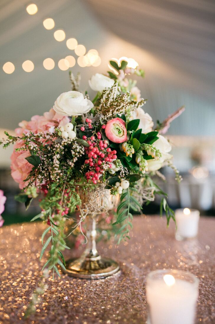 Bouquets and table settings included a mix of cream garden sprays, dusty pink sahara roses, the lightest pink hydrangeas and other florals and greenery.
