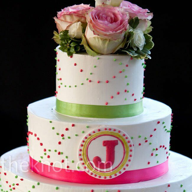 """The cake was spotted with pink and green polka dots and branded with the couple's """"J"""" monogram."""