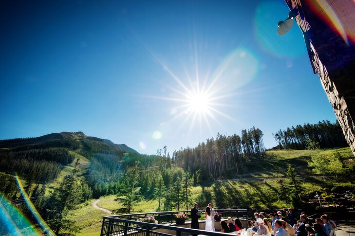 """Crystal and Nathan exchanged vows outside on the deck of Moonlight Basin in Big Sky, Montana. """"The summers are simply heaven in Montana,"""" she says. """"It was a perfect 80 degrees with no humidity and clear blue skies."""""""