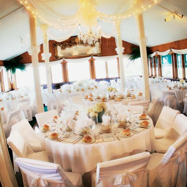 The interior of Windows on the Water maintained a light, clean feel. The tables were covered with white linens and topped with small centerpieces of white blooms in vases covered with blue tweed.