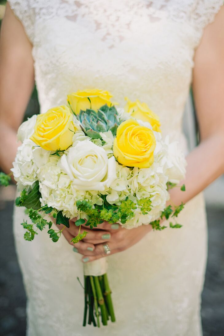 Erin's and her bridesmaids' bouquets comprised white hydrangeas and yellow roses, with some green succulents mixed in.