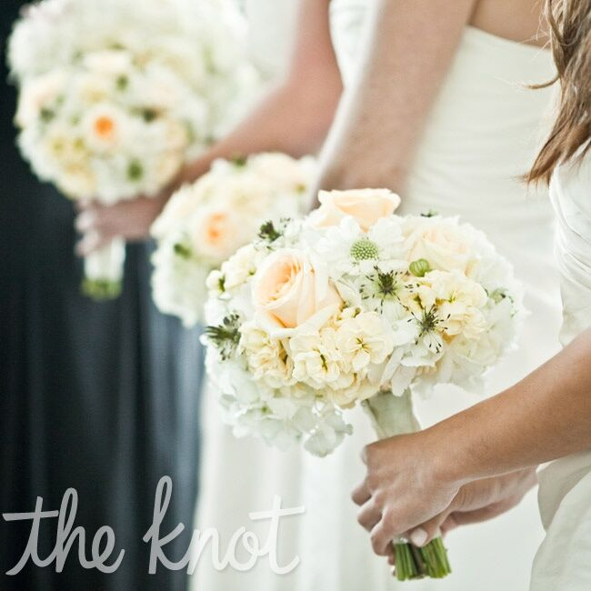 The bridesmaids carried soft fluffy bunches of cream and peach blooms.