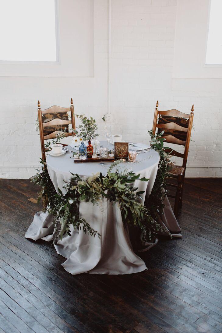 Rustic Garland-Draped Sweetheart Table