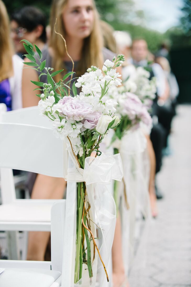 Chairs on the ceremony aisle were decorated with lavender roses and white stock flowers tied together with ivory organza ribbon.
