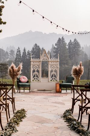 Whimsical Forest Ceremony Site with Vintage Furniture and Pampas Grass